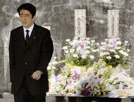 Japan's Prime Minister Shinzo Abe attends a ceremony to mark the anniversary of a bloody World War Two battle at the Peace Memorial Park in Itoman on the southern Japanese island of Okinawa June 23, 2007. REUTERS/Kyodo