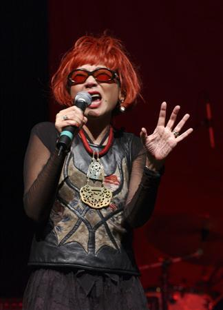 Author Amy Tan sings as part of the Rock Bottom Remainders, a literary garage band, in this 2004 photo. REUTERS/Rock Bottom Remainders Management/Handout