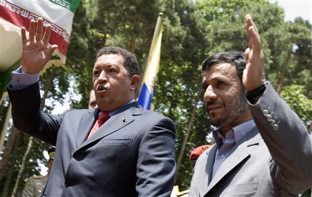 Iranian President Mahmoud Ahmadinejad (R) and his Venezualan counterpart Hugo Chavez gesture during the welcoming ceremony for Chavez in Tehran July 1, 2007. The presidents of Iran and Venezuela launched construction of a joint petrochemical plant on Monday, strengthening an ''axis of unity'' between two oil-rich nations staunchly opposed to the United States. REUTERS/Raheb Homavandi