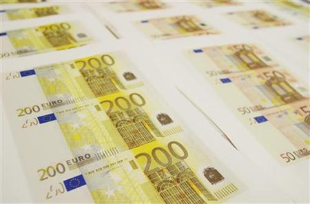 Euro notes in a file photo. A German motorist surprised by euro notes swirling in the air around her car hit the brakes and collected a ''substantial amount of money'' before turning it over to police, authorities in Worms said on Thursday. REUTERS/File