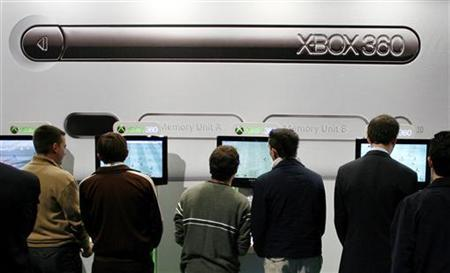 A file photo of visitors playing with Microsoft Corp.'s Xbox 360 game consoles during the opening day of Madrid's International Data Processing, Multimedia and Communications SIMO Fair November 7, 2006. Microsoft Corp. said on Thursday ''an unacceptable number of repairs'' to its Xbox 360 will force it to take a charge of more than $1 billion for its most recent quarter, and it announced a new, extended warranty for the video game console. REUTERS/Victor Fraile