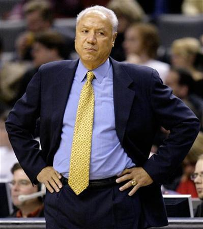 In this file photo former New York Knicks head coach Lenny Wilkens reacts after a basket by the Toronto Raptors during the first half of their NBA game in Toronto, November 24, 2004. Wilkens resigned as vice chairman of the Seattle SuperSonics on Friday, a day after P.J. Carlesimo was appointed head coach. REUTERS/Peter Jones PJ