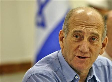 Israel's Prime Minister Ehud Olmert attends a meeting with city leaders in Modiin near Tel Aviv July 3, 2007. Olmert in remarks aired on Tuesday offered Syrian President Bashar al-Assad to begin direct negotiations to make peace in the Middle East, and advised him not to wait for American mediation. REUTERS/Gil Cohen Magen