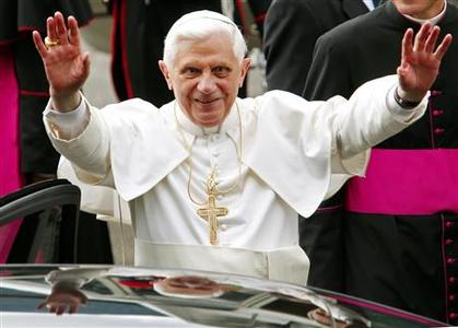 Pope Benedict XVI waves on his arrival for his annual holiday in Lorenzago di Cadore, northern Italy, July 9, 2007. REUTERS/Alessandro Garofalo