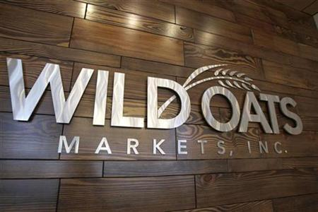 A company sign at the home office of Wild Oats Markets, Inc. is seen in Boulder, Colorado, June 13, 2007. The chief executive of Whole Foods Market Inc. posted messages on a Yahoo! chat forum under an alias for years, talking up his own company while predicting a bleak future for Wild Oats Markets Inc., the rival it has since sought to acquire. REUTERS/Rick Wilking