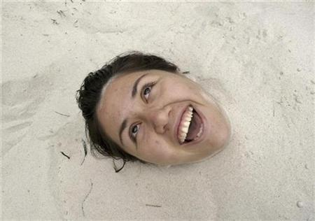 A youth is covered in sand during the opening day of the first of four city beaches in Mexico City, April 3, 2007. Researchers have confirmed what common wisdom has long held -- that people can suppress emotionally troubling memories -- and said on Thursday they have sketched out how the brain accomplishes this. REUTERS/Daniel Aguilar