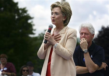 Democratic Presidential candidate and U.S. Senator Hillary Clinton (D-NY) speaks to supporters as her husband, former U.S. President Bill Clinton, looks on as they campaign in Keene, New Hampshire July 13, 2007. REUTERS/Lisa Hornak