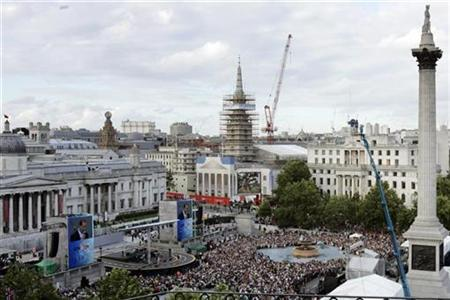 Crowds gather for the Tour de France cycling race opening ceremony in Trafalgar Square in London, July 6 2007. London's building boom has given archaeologists an unexpected bonus -- the city's ancient past is being laid bare. REUTERS/Luke MacGregor