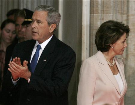 President Bush applauds alongside Speaker of the House of Representatives Nancy Pelosi (D-CA) during a ceremony for agricultural scientist Norman Borlaug in the Rotunda of the U.S. Capitol building in Washington July 17, 2007. REUTERS/Jason Reed