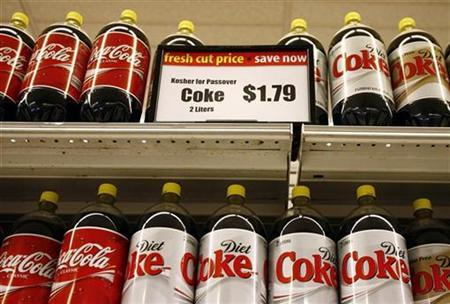 Coke and Diet Coke bottles sit on display at grocery store in Great Neck, New York, March 20, 2007. REUTERS/Shannon Stapleton