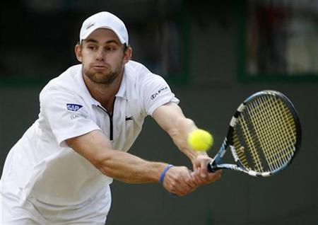 Andy Roddick of the U.S. plays a return during his quarter-final singles match against France's Richard Gasquet at the Wimbledon tennis championships in London, July 6, 2007. REUTERS/Toby Melville/Files