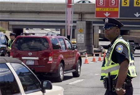 A policeman watches drivers at a checkpoint at New York's John F. Kennedy International Airport, July 1, 2007. Terrorists may be conducting ''dry runs'' at U.S. airports to test security before a possible attack, according to a Transportation Security Administration warning to airport screeners. REUTERS/Meredith Davenport