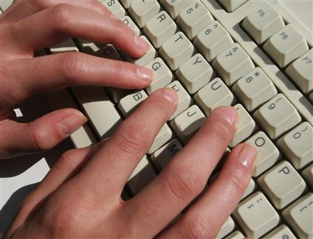 A computer keyboard in a file photo. Connecticut investigators are looking into ''three or more'' cases of convicted sex offenders who had registered on Facebook, a fast-growing social networking Web site, the New York Times reported on Monday. REUTERS/File