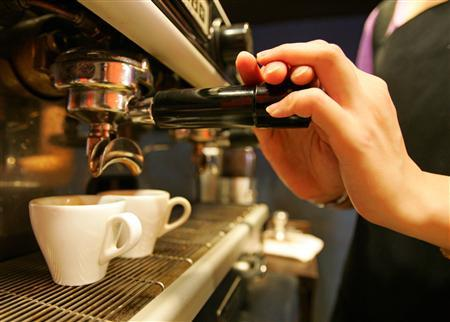 A coffee shop in a file photo. Exercise and moderate caffeine consumption together could help ward off sun-induced skin cancer, researchers said on Monday, but cautioned against ditching the sun screen in favor of a jog and a cappuccino. REUTERS/Richard Chung