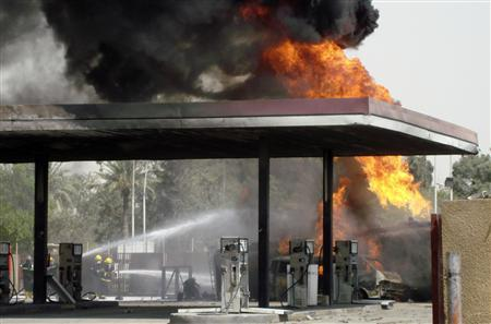 Firemen hose down a burning fuel truck at the site of a suicide bomb attack in Baghdad, August 1, 2007. REUTERS/Mohammed Ameen