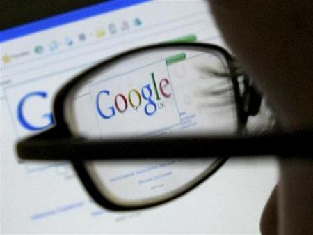 A Google search page is seen through the spectacles of a computer user in Leicester, central England July 20, 2007. Google Inc. <GOOG.O> has approached wireless phone operators and handset makers as it looks for a piece of the market for advertisements on cellphones, the Wall Street Journal said on its Web site on Thursday. REUTERS/Darren Staples
