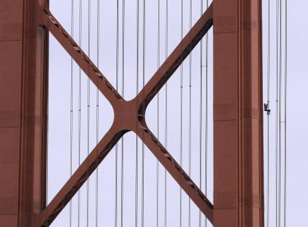 French daredevil climber Alain Robert, known as ''Spiderman'', climbs up the April 25 bridge over the Tagus river in Lisbon August 6, 2007. Robert, 44, completed the 190 metre climb during rush hour on Monday before giving himself up. REUTERS/Marcos Borga