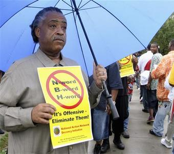 Rev. Al Sharpton holds a rally in the rain in Dearborn, Michigan August 7, 2007, before attending a rally calling for music lyricists to stop using the ''n-word'' and derogatory language towards women in front of the famed former studios of the Motown label in Detroit. REUTERS/Rebecca Cook