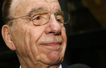 News Corp. chief Rupert Murdoch leaves a midtown Manhattan office building following meetings with several key members of the Bancroft family who control Dow Jones & Co. Inc., June 4, 2007. Murdoch's News Corp on Wednesday said fourth-quarter profit rose 4.5 percent on higher advertising sales and affiliate revenue from the Fox News Channel and on more new subscribers at the Sky Italia satellite TV service. REUTERS/Mike Segar