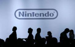 <p>Journalistas durante coletiva da Nintendo em Chiba. O lucro da Nintendo quase triplicou no primeiro semestre, e anunciou elevação na projeção de resultados, enquanto os populares sistemas de videogame Wii e DS continuam a superar em vendas o PlayStation. Foto do Arquivo. Photo by Yuriko Nakao</p>