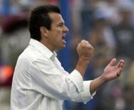 <p>Dunga, técnico da seleção brasileira de futebol, vai dirigir também a seleção olímpica em Pequim, informou a Confederação Brasileira de Futebol (CBF) nesta sexta-feira. Photo by Jose Miguel Gomez</p>