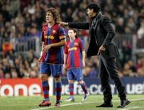 <p>Capitão Puyol se diz preocupado com falta de empenho do Barça. O capitão do Barcelona, Carles Puyol, criticou a falta de empenho de sua equipe depois da derrota de 2 x 0 fora de casa para o Getafe, que tirou do clube a chance de passar adiante do líder Real Madrid. 7 de novembro. Photo by Gustau Nacarino</p>
