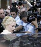 <p>Kidman temeu acidente durante perseguição de fotógrafo. A atriz Nicole Kidman disse na segunda-feira a um tribunal australiano que chorou de medo de um acidente ao ser perseguida por um fotógrafo na Austrália em 2005. 19 de novembro. Photo by Will Burgess</p>