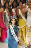 <p>Miss China Zhang Zilin reacts after been crowned as Miss World 2007 in Sanya on the Chinese island of Hainan December 1, 2007. REUTERS/ Nir Elias</p>