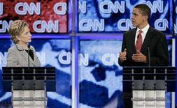<p>Senator Barack Obama (D-IL) (R) gestures as Senator Hillary Clinton (D-NY) listens at the CNN/Nevada Democratic Party debate in at the University of Nevada Las Vegas (UNLV) in Las Vegas, Nevada November 15, 2007. REUTERS/Steve Marcus</p>