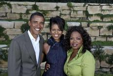 <p>Oprah Winfrey (R) poses with Senator Barack Obama (L) and his wife Michelle Obama at an Obama '08 fund-raiser for Barack Obama's presidential campaign, hosted by Winfrey at her home in Montecito, California September 8, 2007. REUTERS/Harpo, Inc./Handout</p>