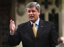 <p>Prime Minister Stephen Harper stands to speak in the House of Commons on Parliament Hill in Ottawa December 4, 2007. REUTERS/Chris Wattie</p>