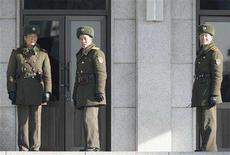 <p>North Korean soldiers look south at the truce village of Panmunjom in the demilitarised zone separating the two Koreas, about 55 km (34 miles) north of Seoul, December 5, 2007. North Korea may miss the year-end deadline under an international disarmament deal to provide a full accounting of its nuclear weapons program, South Korea's foreign minister indicated on Thursday. REUTERS/Jo Yong-Hak</p>