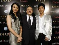 "<p>Director of the movie Ang Lee (C) poses with cast members Tang Wei (L) and Wang Leehom at the premiere of ""Lust, Caution"" at the Academy of Motion Picture Arts and Sciences in Beverly Hills, California, October 3, 2007. REUTERS/Mario Anzuoni</p>"