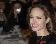 "<p>Angelina Jolie poses at the premiere of ""Beowulf"" in London November 11, 2007. REUTERS/Anthony Harvey</p>"