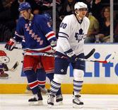 <p>Toronto Maple Leafs center Nik Antropov (80) reacts with a grin as he skates past New York Rangers defenseman Marek Malik (8) after he tipped a shot into the net for his third goal in the third period of their NHL game in New York, December 6, 2007. REUTERS/Ray Stubblebine</p>