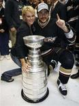 <p>In this file photo Anaheim Ducks' Teemu Selanne of Finland and his wife Sirpa pose with the Stanley Cup after Game 5 of the 2007 NHL Stanley Cup Finals hockey series in Anaheim, California, June 6, 2007. The Canadian Broadcasting Corp. said Thursday it gave the National Hockey League a sneak peek of an upcoming series about the wives and girlfriends of fictional pro hockey players, after the league expressed concern about the drama's salacious subject matter. REUTERS/Mike Blake</p>
