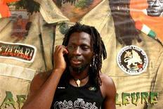 <p>Ivory Coast reggae star Tiken Jah Fakoly talks on his mobile phone at his home and recording studio in Bamako, Mali, March 9, 2006. Fakoly on Saturday plays his first concert in his native Ivory Coast since the start of a civil war five years ago, when his biting political lyrics drove him into exile. REUTERS/Rainer Schwenzfeier</p>