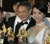 "<p>Actress Tang Wei, Director Ang Lee and Actor and Singer Wang Lee-hom pose backstage at the 44th Golden Horse Awards in Taipei December 8, 2007. Lee's ""Lust, Caution"" won him Best Feature Film, Best Director, The Outstanding Taiwanese Filmmaker of the Year and Tang the Best New Performer awards. REUTERS/Bobby Yip</p>"