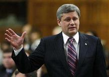<p>Prime Minister Stephen Harper stands to speak in the House of Commons on Parliament Hill in Ottawa December 10, 2007. Harper lashed out at the country's nuclear regulator on Tuesday for refusing to allow the reopening of a reactor that makes crucial radioisotopes for cancer tests. REUTERS/Chris Wattie</p>