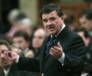 <p>Finance Minister Jim Flaherty stands to speak in the House of Commons on Parliament Hill in Ottawa November 21, 2007. Flaherty said on Tuesday he was concerned that delays by opposition parties could jeopardize the timing of a sales tax cut that was to go into effect on January 1. REUTERS/Chris Wattie</p>