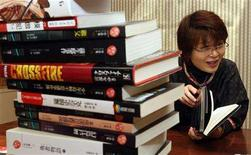 <p>Japanese novelist Miyuki Miyabe speaks during an with Reuters in Tokyo November 26, 2007. Miyabe has gone from being an office clerk who wrote only on weekends to becoming one of Japan's most popular, prolific and prize-winning authors with 46 novels to her name. REUTERS/Kim Kyung-Hoon</p>
