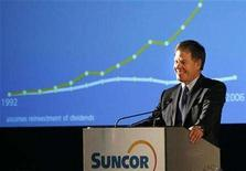 <p>Rick George, president and chief executive of Suncor Energy Inc., smiles at an annual general meeting in Calgary, Alberta, April 26, 2007. George said on Wednesday he is optimistic that the major oil sands producer can strike a deal with the Alberta government on changes to its royalty structure. REUTERS/Todd Korol</p>