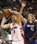 <p>Toronto Raptors forward Andrea Bargnani goes to the basket against Dallas Mavericks forward Dirk Nowitzki (R) during the first half of their NBA game in Toronto, December 12, 2007. REUTERS/ Mike Cassese</p>