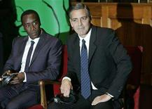 <p>U.S. actors George Clooney and Don Cheadle (L) attend a ceremony for the 2007 Peace Summit Award at the city hall in Rome December 13, 2007. Clooney and Cheadle received the award from Nobel peace prize laureates for their campaign to help the people of Sudan's Darfur region after 4-1/2 years of war. REUTERS/Dario Pignatelli</p>