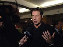 "<p>Actor John Travolta is interviewed at a 30th anniversary screening of ""Saturday Night Fever"" held at the Academy of Motion Picture Arts and Sciences in Beverly Hills, California November 20, 2007. He's played stone cold killers, sexy leading men and military heroes, but Travolta figures his best role yet may just be the woman he portrays in movie musical ""Hairspray."" REUTERS/Phil McCarten</p>"