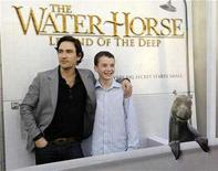 "<p>British actors Ben Chaplin (L) and Alex Etel, cast members in ""The Water Horse: Legend of the Deep"" pose together at the premiere of the film in Los Angeles, December 7, 2007. Family films that won't make adults gag are always in short supply, so a pleasing British fantasy, ""The Water Horse: Legend of the Deep,"" is a welcome addition to the holiday season. REUTERS/Chris Pizzello</p>"