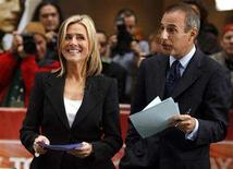 "<p>Meredith Vieira (L) smiles beside co-host Matt Lauer during her first day on NBC's ""Today"" show in New York September 13, 2006. REUTERS/Brendan McDermid</p>"