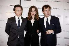 "<p>(L-R) Cast members James McAvoy (L) and Keira Knightley (C) with director Joe Wright arrive for the premiere of the film ""Atonement"" at the IFC Center in New York December 3, 2007. REUTERS/Rahav Segev</p>"