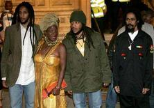 <p>Sons of late reggae star Bob Marley, (L to R) Julian, Stephen and Damien Marley,together with their mother Rita (2L) arrive for the annual Music of Black Origin (MOBO) Awards at the Royal Albert Hall in central London in this file photo from September 22, 2005. More than 26 years after his death, Bob Marley continues to sell records, topping Billboard's year-end Top Reggae Albums chart. Carrying on the family tradition, Marley's sons Stephen and Damian claim the No. 2 and 3 rungs on the year-end reggae albums chart. REUTERS/Toby Melville</p>