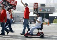<p>Jim Shaughnessy (R on scooter), a writer for NBC's 'The Tonight Show with Jay Leno', takes part in the picket line with other writers at NBC television network studios in Burbank, California November 5, 2007. Late-night TV hosts Jay Leno and Conan O'Brien plan to cross picket lines to resume taping shows on January 2, nearly two months after the Hollywood writers strike forced them off the air, the NBC network said on Monday. REUTERS/Fred Prouser</p>
